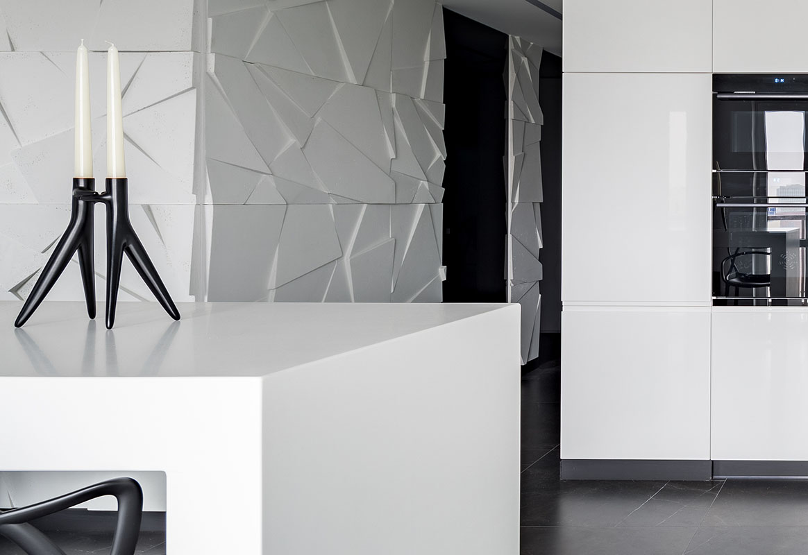 Panoramic view of monochromatic white luxury kitchen with black details